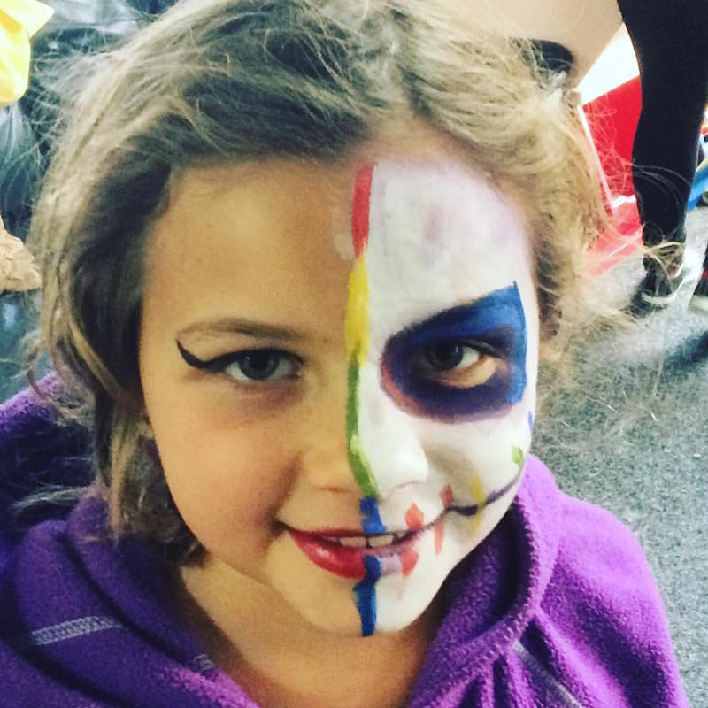 Alpha with her face painted at On the Corner