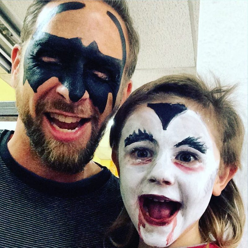 Lennox and Dad with painted faces at On the Corner